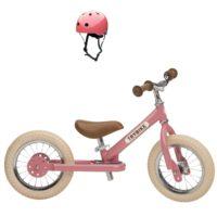 Draisienne trybike de couleur rose avec casque