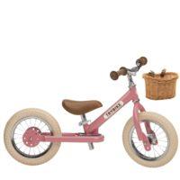Draisienne trybike de couleur rose avec panier
