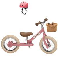 Draisienne trybike de couleur rose avec panier osier et casque